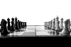 The abstract image of the chess board and Staunton chess set laying on table and white copy space. royalty free stock photography