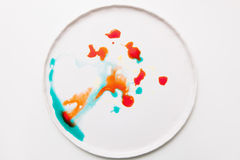 Abstract image of colorful splashes on white royalty free stock photography