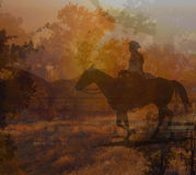 Cowboy riding on a horse IV. An abstract image of a cowboy riding his horse into the sunset through dense foliage in complimentary colors of yellow, orange royalty free stock photography