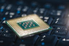 The abstract image of the CPU laying on the computer`s keyboard. stock photos
