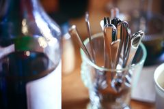 Abstract image of cutlery in cafe or coffee shop. Abstract blurred image of cutlery in cafe or coffee shop, close-up and selective focus stock images