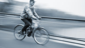 Abstract image of cyclist on the city roadway Royalty Free Stock Photos