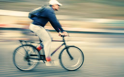 Abstract image of cyclist on the city roadway. Stock Images