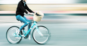 Abstract image of cyclist on the city roadway. Royalty Free Stock Photo