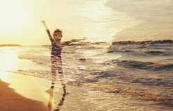 Abstract image of Double exposure of sea sunset and cute happy kid. freedom concept Royalty Free Stock Images