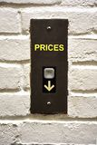 Elevator button indicating how to decrease prices. Abstract image of elevator button indicating how to decrease prices Stock Images
