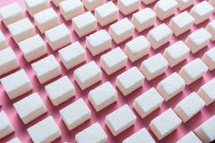 Abstract image of evenly spaced sugar cubes.  stock images