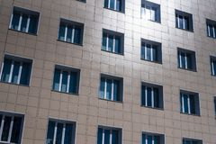 Abstract image of the facade of the building with Windows covered with plastic panels.  Royalty Free Stock Photos