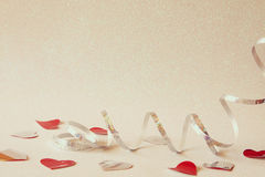 Abstract image of festive ribbon decoration and hearts Stock Photo