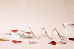 Abstract image of festive ribbon decoration and hearts Stock Images