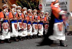 An abstract image of a group of participants in a traditional local festival of parades of costumed people of Muslim Moors stock photo