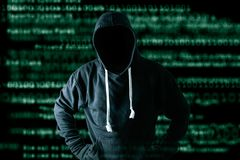 The abstract image of the hacker standing and the binary code image is backdrop. the concept of cyber attack, virus, malware, ille stock photos