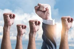 The abstract image of the hands rising up to the sky. The concept of teamwork, successful, rising and power stock photo