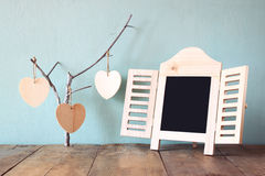 Abstract image of hanging wooden hearts over wooden background Stock Photography