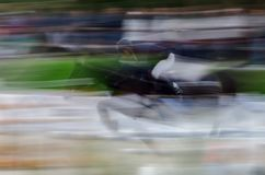 Abstract image with a horse at show jumping royalty free stock photo