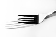 Abstract image for kitchen. Fork shadow Stock Image