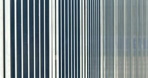 Abstract image with low depth of field (DOF) from the bars of a barrier before a sports stadium. Germany Stock Photo