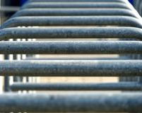 Abstract image with low depth of field (DOF) from the rows of entrances to an arena separated by metal brackets. Germany Stock Photography