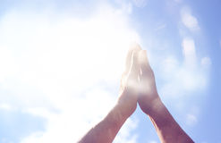Abstract image of male hands reaching for the sky. room for text. double exposure. Stock Photo