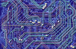 Abstract image of microcircuit against a blue background.  Stock Photos