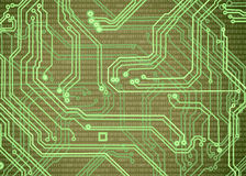 Abstract image of microcircuit against a green background close-up. Abstract image of microcircuit against a green background closeup Royalty Free Stock Photo