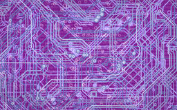 Abstract image of microcircuit against a purple background closeup Stock Images