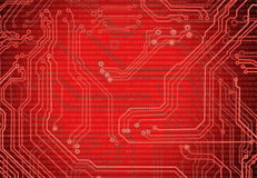 Abstract image of microcircuit against a red background close up Royalty Free Stock Images