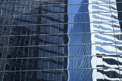 Abstract image of modern office building facade with reflections Stock Images
