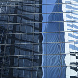 Abstract image of modern office building facade with reflections Royalty Free Stock Image