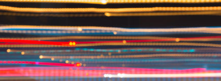 Abstract image of night lights in motion blur in the city. Stock Image