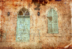 Abstract image of old house's wall from jerusalem stone with old blue balcony. filtered and textured image Royalty Free Stock Photo
