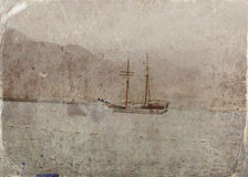Abstract image of one yacht at open sea. Old style photo. Stock Photos