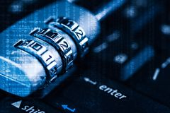 The abstract image of the padlock located on the top of enter button on computer keyboard overlay with binary code image. royalty free stock photo