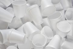 White Styrofoam Coffee Cups. An abstract image of several white Styrofoam coffee cups in a heap Royalty Free Stock Images