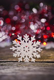 Abstract image of snowflakes on a wooden background. Royalty Free Stock Image