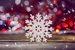 Abstract image of snowflakes on a wooden background. Stock Photography