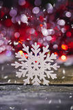 Abstract image of snowflakes on a wooden background. Stock Photo