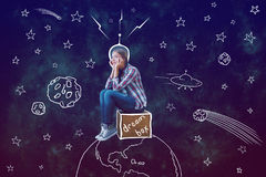 Dream concept. Abstract image of thoughtful young woman sitting on box placed on abstract drawn planet in space. Dream concept stock image