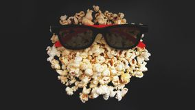 Abstract image of viewer, 3D glasses and popcorn on black background royalty free stock photography