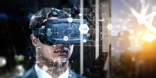Abstract image of virtual reality experience, a man in VR glasses stock photos