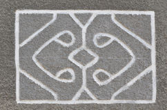 Abstract image on the wall. An abstract relief pattern is depicted on a cement wall coat Stock Image