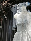 Abstract image of wedding dress or career choice. Reflection of modern architecture on a wedding dress causing a dream-like message to the woman - career or Stock Photo