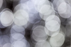 Abstract image of white bokeh from lighting. Abstract image of blurry large circular bokeh background of white light stock photo