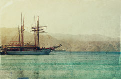 Abstract image of the yacht at sea. Old style photo Stock Photography