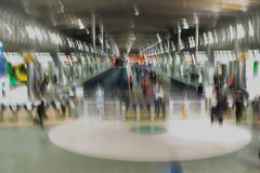 Abstract impressionist background of Britomart rail train transportation centre in Auckland, New Zealand, NZ. Abstract impressionist background of commuters at royalty free stock photos