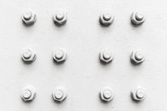Abstract industrial background, bolts and nuts Stock Image