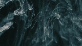 Abstract Ink colour flowing in water stock video footage