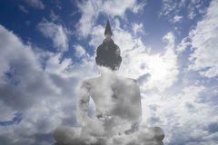 Abstract insert sky in image of Buddha with blue sky and cloud in background, prachuapkhirikhan,thailand,filtered image Stock Photography