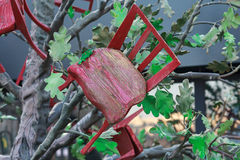Abstract installation: stool growing out of a tree Royalty Free Stock Photo