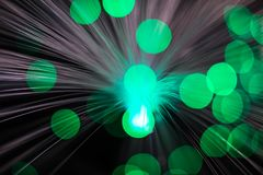 Abstract, intentionelly defocused lights on optical fibres. Technology background image stock images